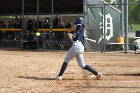 Hitting the ball, junior Lauren Florez aims towards the outfield.