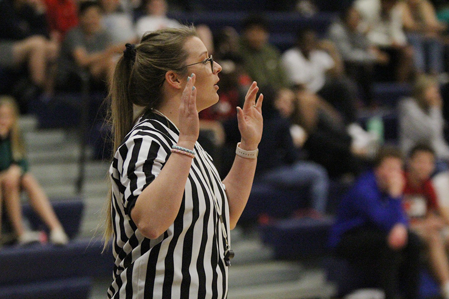 As a referee in the Student vs. Faculty game, science teacher Jessica Long calls a foul on Tuesday, April 30.