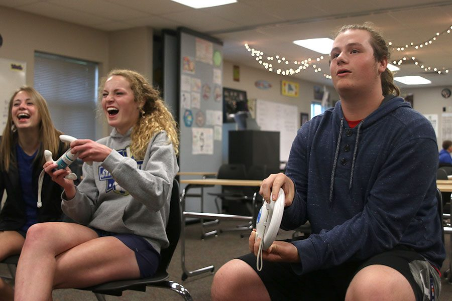 "At the first school Mario Kart tournament on Wednesday, May 5, junior Charlie Schwartzkopf plays sophomore Molly Ricker in the first round of the tournament. ""It was fun that this tournament brought all these people together"" Schwartzkopf said."
