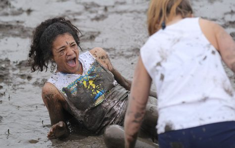 Looking up at a teammate, freshman Sydnie Short recovers from falling into the pool of mud.