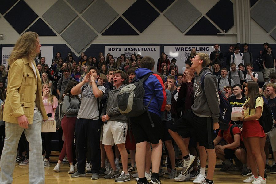 As the assembly comes to a close, the junior class participates in