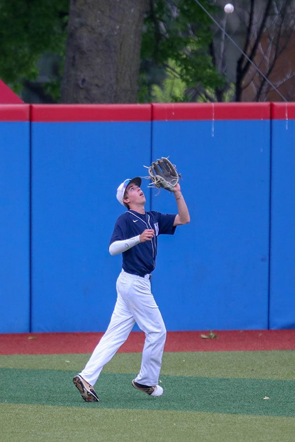 Looking towards the ball, senior Matt Smith lines up to catch the pop fly, Friday, May 24.
