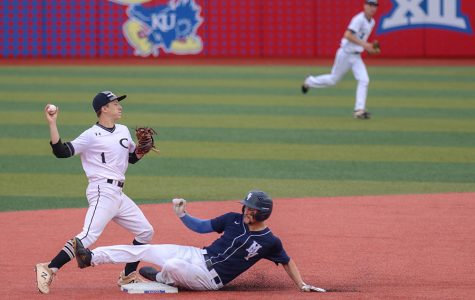 Down on the turf, senior Quinton Hall slides into second base, Friday, May 24.