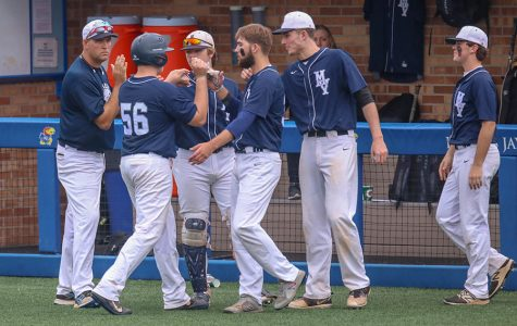 At last year's state baseball tournament, players gather near the dugout to celebrate. This year's baseball season, as well as all other spring sports, are currently set to proceed as normal. However, other local leagues like the Heartland Soccer Association and national leagues like the NCAA, NBA and MLB have cancelled games.