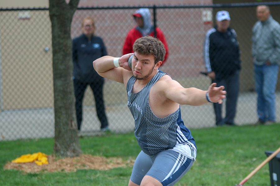 Focusing on his form, senior Christian Roth prepares to throw the shot put. Roth placed 6th in the shot put.