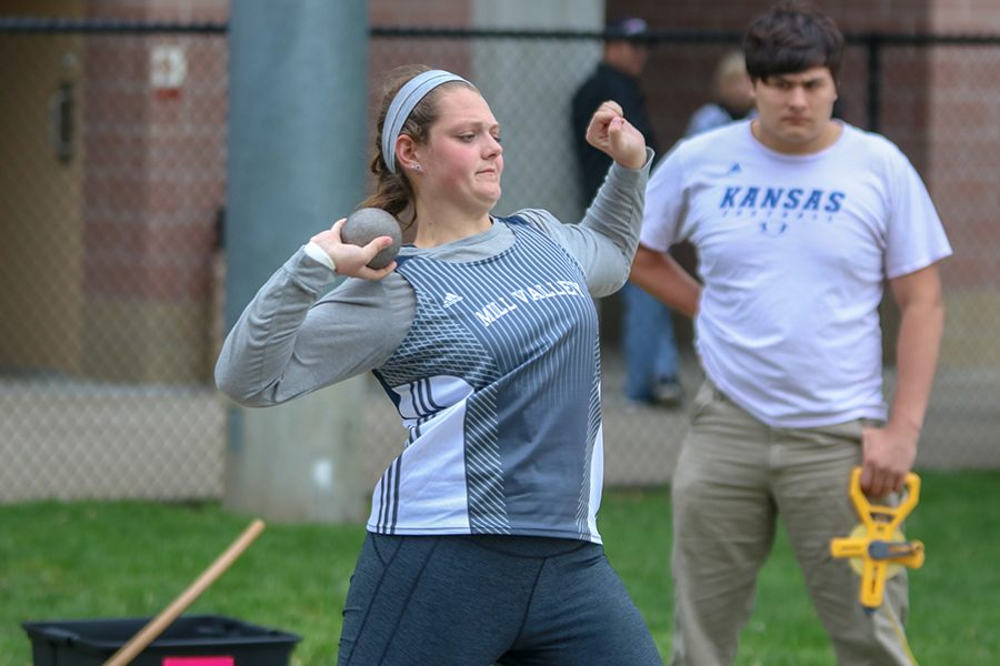 Looking towards the pit, senior Makayla King prepares to throw the shot put.