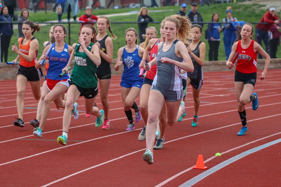 Starting the 4x800 meter relay, sophomore Molly Ricker leads a pack of runners.