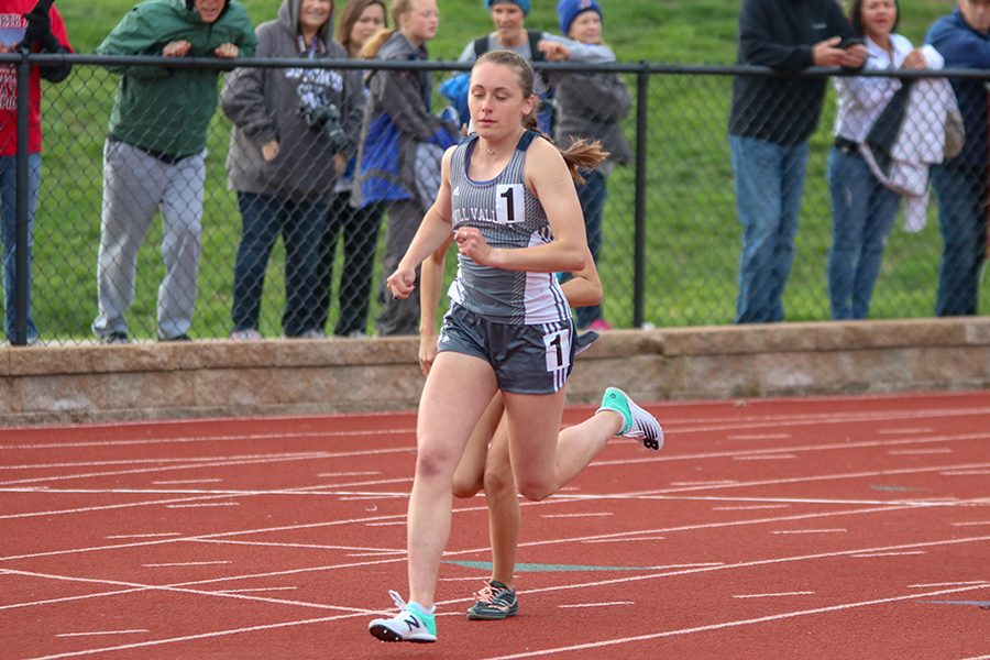 After the starting the gun, senior Delaney Kemp begins the 1600 meter run. Kemp finished first and broke the school record with a time of 5:07.