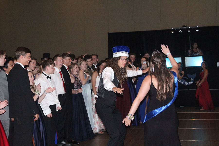 Prom+king+and+queen%2C+Dylan+Wootton+and+Marah+Shulda%2C+come+together+on+the+dance+floor+for+their+first+dance.%0A