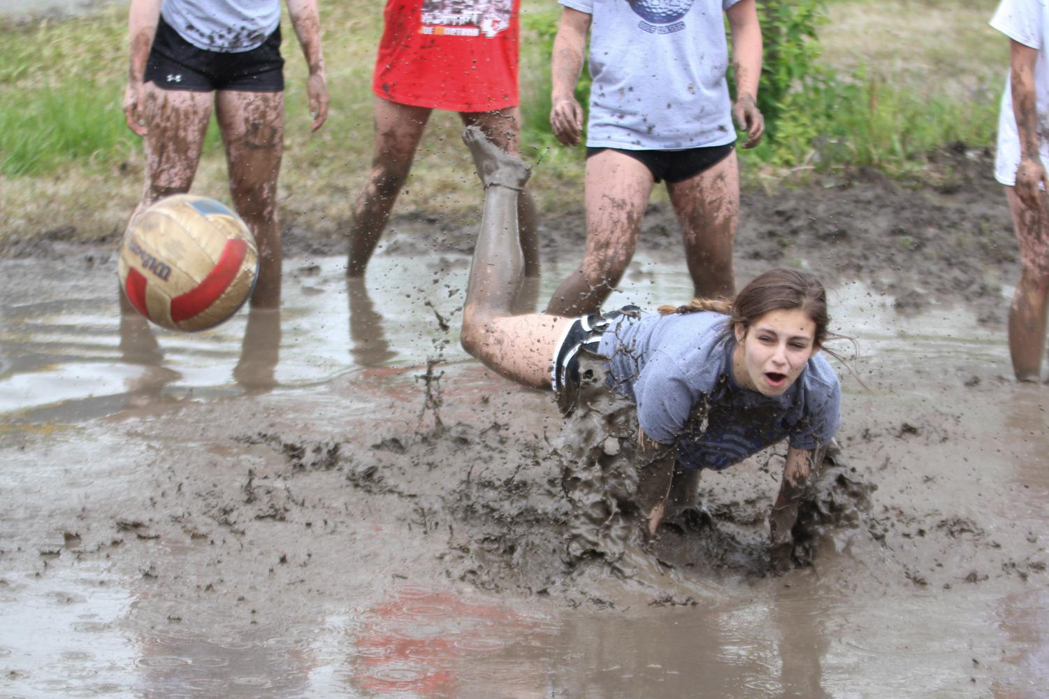 After+trying+to+reach+the+ball%2C+freshman+Lauren+Payne+falls+into+the+mud.