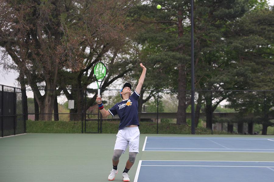 In+his+singles+match%2C+freshman+Gage+Foltz+serves+the+ball.+