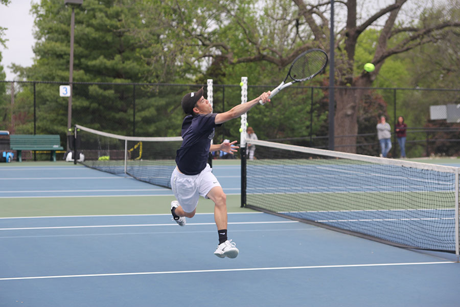 Jumping%2C+senior+Eric+Schanker+returns+the+ball.%0A