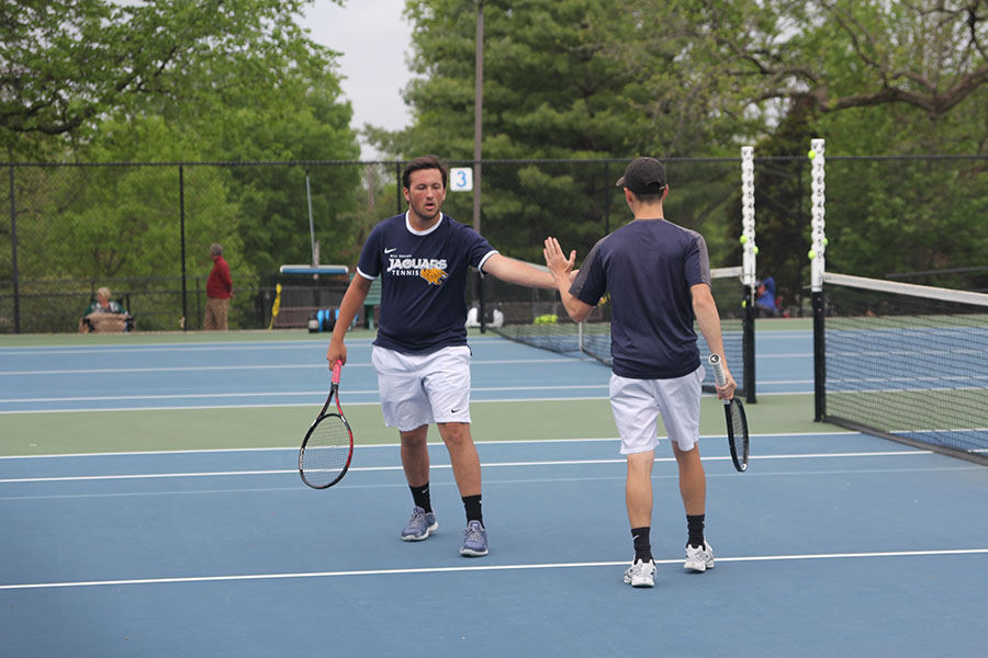 During+their+doubles+match%2C+seniors+Eric+Schanker+and+Jacob+Hoffman+high+five.%0A