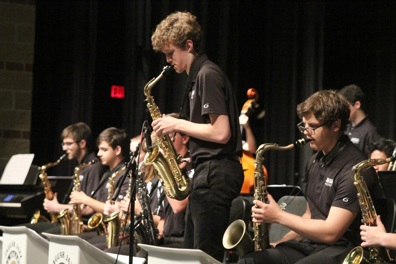 During a Jazz Band concert Tuesday, April 30, sophomore John Fraka plays a solo on his saxophone during the song Teaneck.