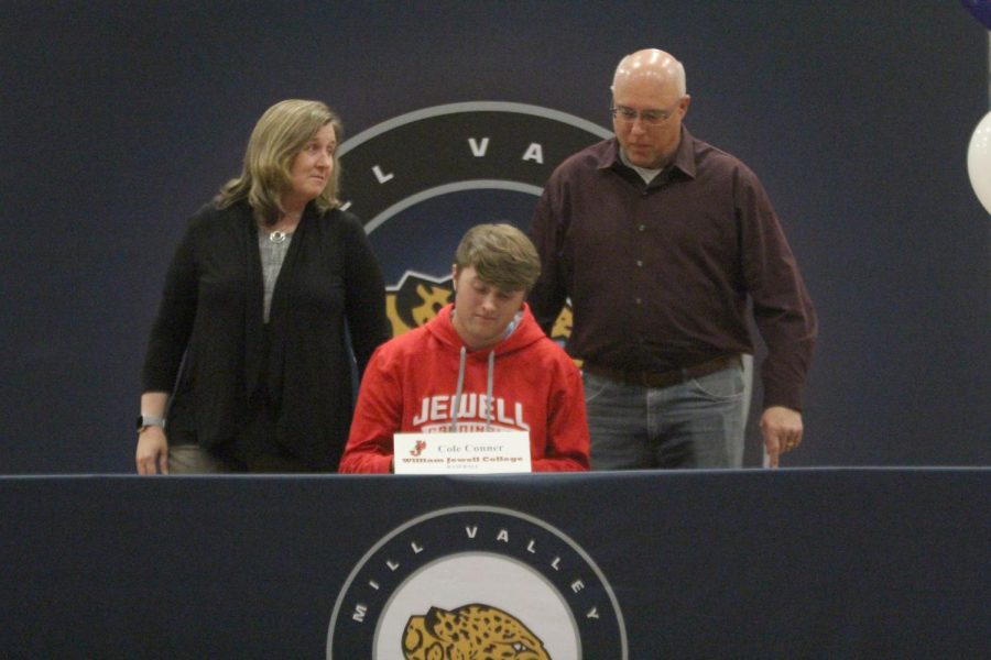 After signing to play baseball at William Jewel College, Cole Conner sits with his parents.