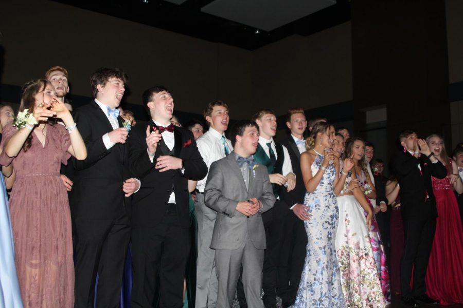 Students enjoy watching the prom queen and kind dance.