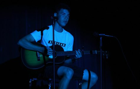 "Singing the song ""When You Love Someone"", senior Eric Shanker performs a guitar and vocal solo at the talent show on Thursday, May 2."