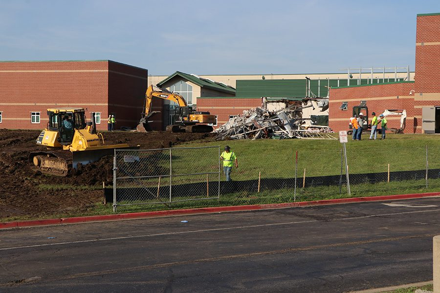 Less than 12 hours after the fire started, construction workers continue to demolish the weight room, Friday, June 7.