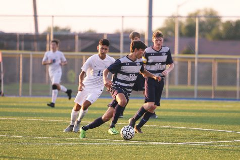 After gaining control of the ball from his opponent, senior Anthony Pentola dribbles the ball in the opposite direction during the game against Gardner on Friday, Aug. 30.