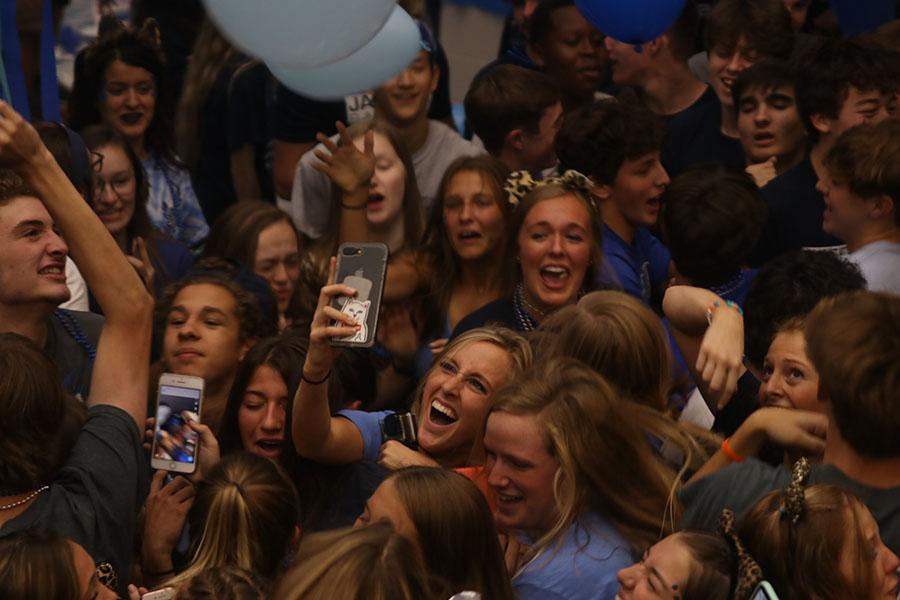 Senior Annie Hoog takes a selfie in the middle of the Blue Bomb chaos.