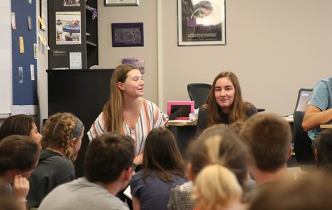 Explaining the Women's Empowerment Club's purpose, juniors Avery Kuehl and Grace McLeod address future club members at their first meeting on Thursday, Sept. 5.