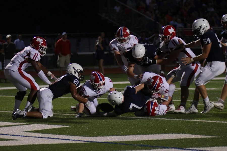 Football team's comeback falls short in wild 42-35 loss to Bishop Miege