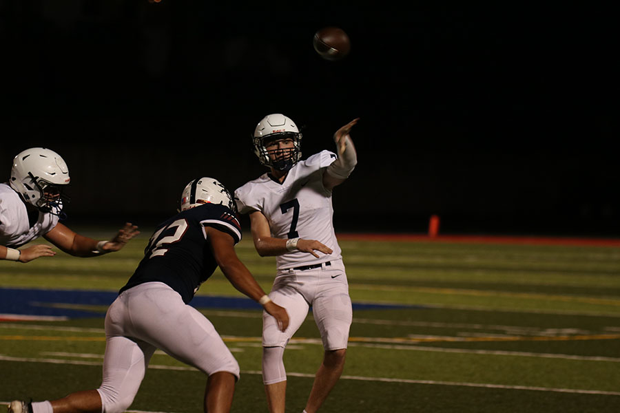 Junior quarterback Cooper Marsh fires the ball downfield during the team's 27-7 win over St. James Friday, Sept. 13.