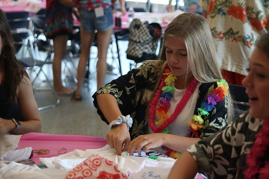 Freshman Brianna Coup twists her T-shirt in order to tie-dye it.