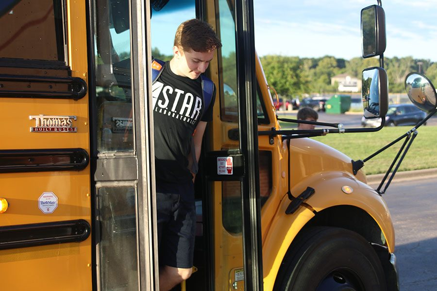 Getting off the bus, sophomore Jakob Patterson heads towards the ground level entrance of the school because the front entrance has been blocked off.