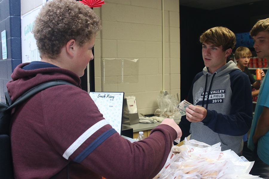 On the opening day of the Catty Shack, sophomore Declan Taylor buys his hot cookie.