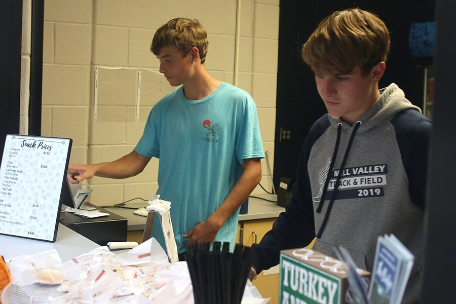 In the midst of a big rush, seniors Nick Schmidt and Josh Glunt man the Catty Shack on Tuesday, Sept. 24.