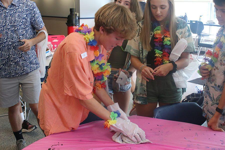 Finishing up his shirt, freshman Sonny Pentola unravels his shirt.
