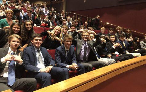 Waiting for the ceremony to begin, the team displays the DECA hand sign. The team competed Tuesday, Sep. 17 at Johnson County Community College.