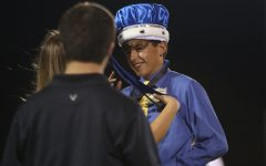 Homecoming king and queen crowned at halftime of football game