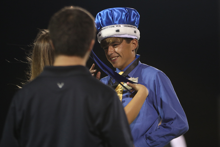 Being crowned, homecoming king winner Ben Stove smiles.