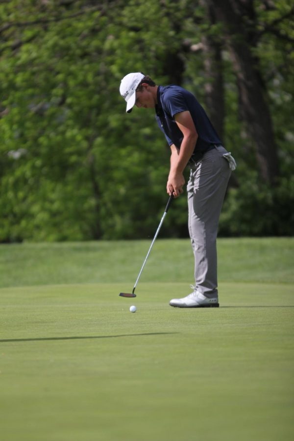 Junior Nick Mason watches his putt roll towards the hole at the Ironhouse Invitational Wednesday May 6, 2019. Mason is still deciding where he will commit.