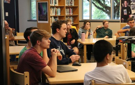 Students gather in the library to listen to a guest speaker Mona Lyne before watching the Democratic debate.