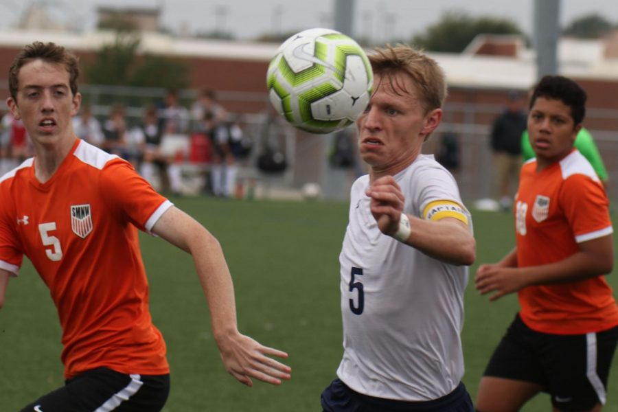 Senior Ian Carroll, stares down the ball after bouncing it off his chest.
