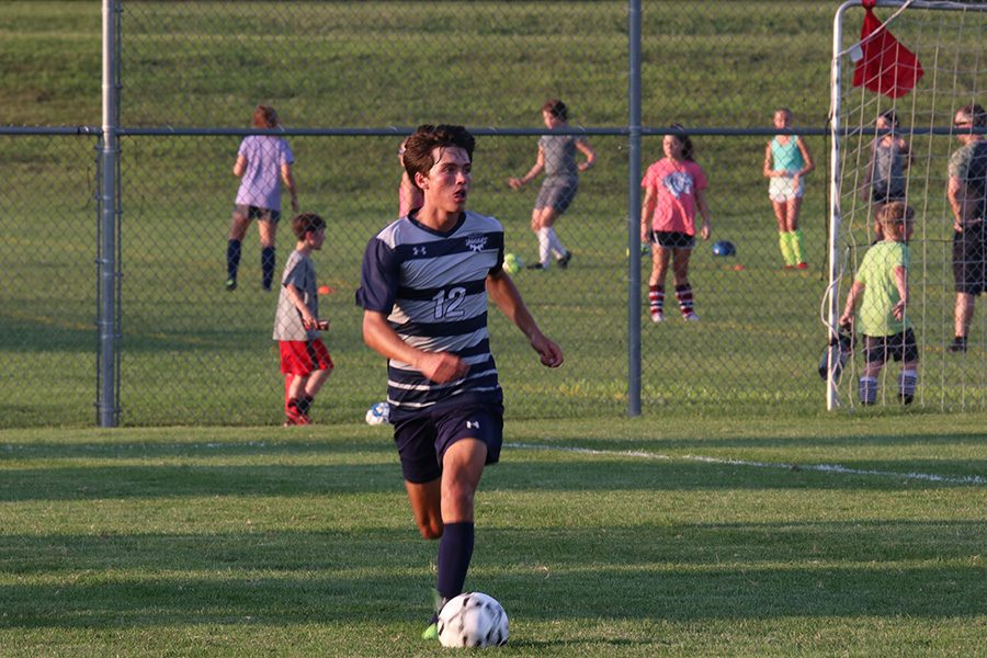 Anthony Pentola, quickly dribbles up the field after retrieving the ball.