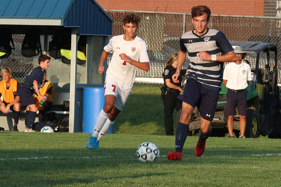 Riley Ferguson steals the ball from the opposing team and heads for the goal.