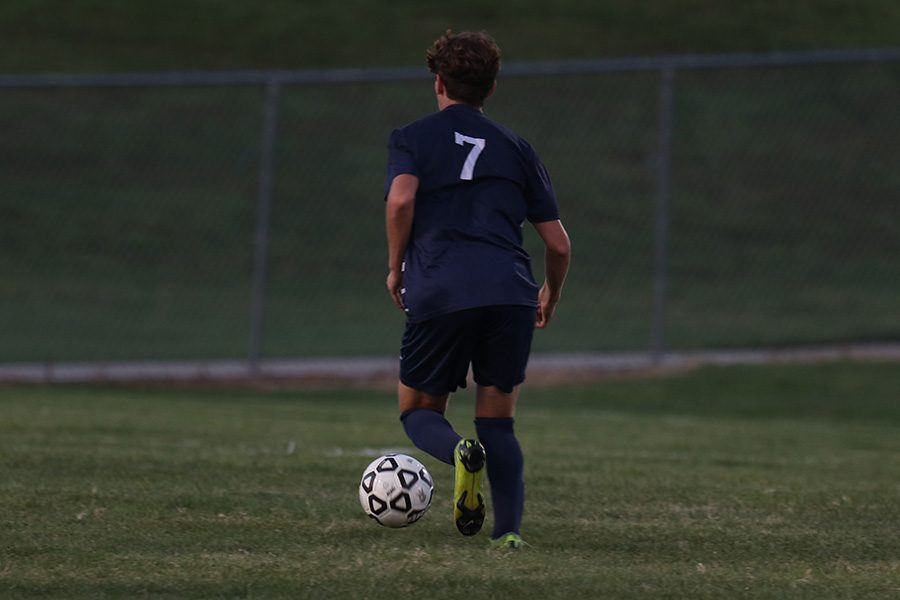 Yahel Anderson slowly dribbles down the field.