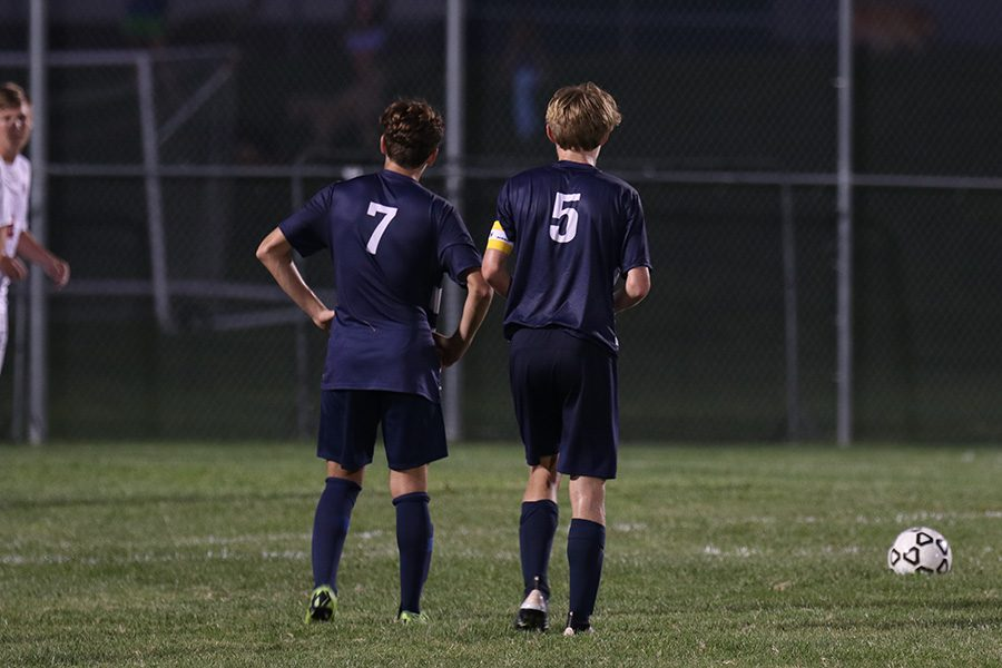 Ian Carroll and Yahel Anderson overview the field as Yahel gets ready for a penalty kick.