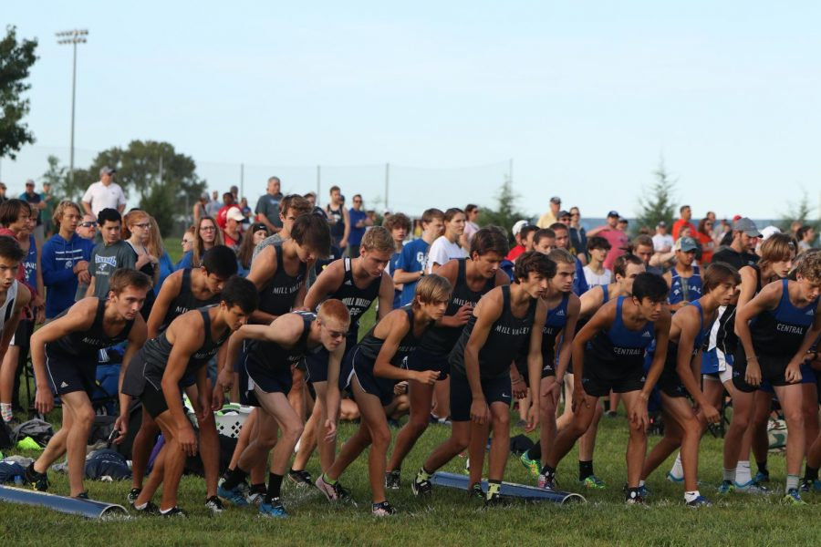 Lining up to start the race the varsity boys listen for the start signal and stand in their positions.