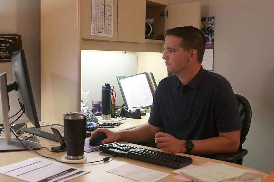After the construction got rid of his office window, school counselor Chris Wallace has to work in the dark.