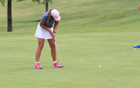 With a putter in hand, sophomore Libby Green follows through finishing her hole. Green won third place overall at the Shawnee Golf and Country Club on Tuesday, Sept. 10.