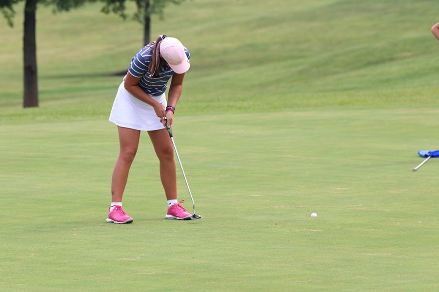 With+a+putter+in+hand%2C+sophomore+Libby+Green+follows+through+finishing+her+hole.+Green+won+third+place+overall+at+the+Shawnee+Golf+and+Country+Club+on+Tuesday%2C+Sept.+10.%0A