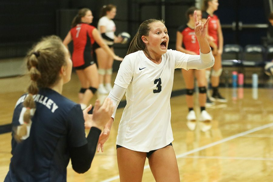 After+a+point+is+scored%2C+junior+Jaden+Ravnsborg+rallies+her+teammates+in+a+match+against+Shawnee+Mission+West+on+Thursday%2C+Sept.+5.+
