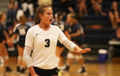 With an outstretched hand, junior Jaden Ravnsborg gets the attention of her teammates.