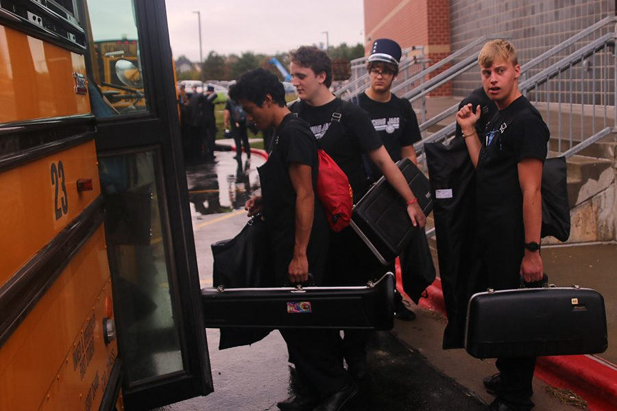 Senior+Nico+Gatapia+and+junior+Aidan+Cannon+shuffle+onto+the+bus%2C+instruments+in+hand+before+heading+to+Emporia.++