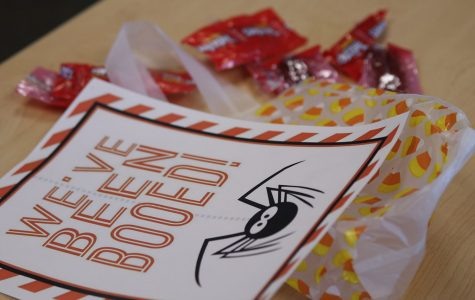 """Social studies teacher Angie DalBello received goody bag and left it with only wrappers. Student Ambassadors gave spooky surprises to seminar teachers during their annual """"You've Been Boo'd"""" event Wednesday, Oct. 23."""